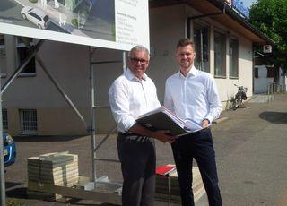 Bürgermeister und Daniel Runow (STEG)