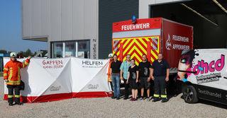 Bürgermeister Manuel Tabor, Dieter Harter, Katja Harter, André Dycker (DHCD), Abteilungskommandant Appenweier Christian Brudy stellen die Neuerungen in Appenweier vor.